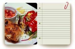 Comida y libreta imagenes de archivo