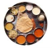 Comidas de placa indias con el chapati, el rasam y el sambar fotos de archivo libres de regalías