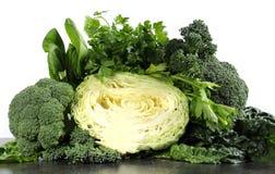 Comidas sanas de la dieta sana con las verduras verdes frondosas Imagen de archivo