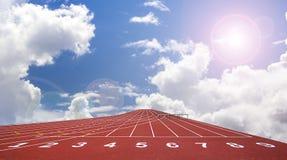 Comience la pista. alinee en una pista corriente roja Foto de archivo libre de regalías