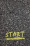 Comience pintado en el pavimento Imagen de archivo libre de regalías