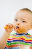 Comiendo el alimento de los bebés sucio Imágenes de archivo libres de regalías