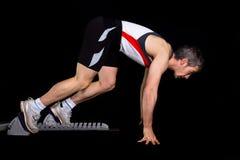 Comienzo Sprinting de un atleta foto de archivo libre de regalías