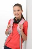 Coming back to school. Happy teenage schoolgirl  looking at came Stock Image