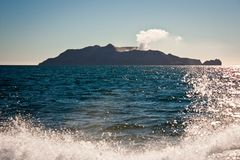 Coming closer to White Island in New Zealand. Natural volcanic park royalty free stock photo