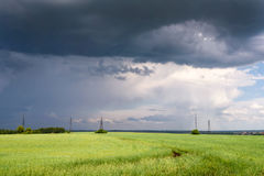 Coming Heavy Thunderstorm over Meadow at Summer Day Royalty Free Stock Photo