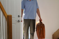 Coming Home. Man arriving from business travel inside the front door of his home stock photo
