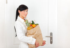 Coming home with food buyer. Female bag holding buyer woman stock images