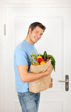 Coming home with food buyer. Attractive male bag holding buyer man royalty free stock photo