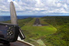Coming in for landing. Motorized glider's final approach to single landing strip at Hana airport on Maui, Hawaii Stock Image