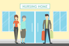 Coming at nursing home. Seniors and helpers. People relax and do hobbies Royalty Free Stock Photos