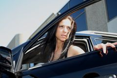 Coming out of the car. Model posing at a photo shoot royalty free stock images