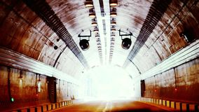 Coming out of the dark tunnel drive. slow motion. 3840x2160. Coming out of the dark tunnel drive stock video footage
