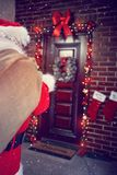Coming of Santa Clause in home stock photos
