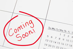 Coming soon. Closeup of a calendar with Coming Soon text in red royalty free stock images