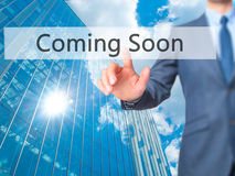 Coming Soon - Businessman click on virtual touchscreen. royalty free stock photography