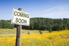 Coming Soon concept. Written on a field sign royalty free stock photos