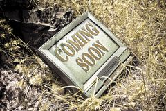 Coming soon concept written on an screen of an old CRT televisio. N - toned image Royalty Free Stock Photos