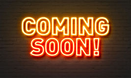 Coming soon neon sign on brick wall background. Coming soon neon sign on brick wall background Royalty Free Stock Photo