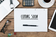 Coming soon on notebook on Office desk with computer technology, Royalty Free Stock Photography