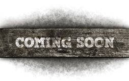 Coming soon. On old wooden board royalty free stock photo