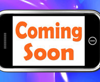 Coming Soon On Phone Shows Arriving Products Or New Arrivals. Coming Soon On Phone Showing Arriving Products Or New Arrivals Royalty Free Stock Photos