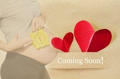 Coming soon. Pregnant woman Royalty Free Stock Photos