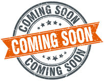 coming soon round orange grungy isolated stamp Royalty Free Stock Photography