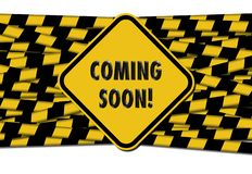 Coming soon sign over barrier tapes royalty free stock photography