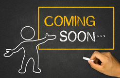 Coming soon. And small people on chalkboard Royalty Free Stock Photography