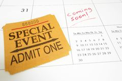 Coming Soon. Special Event ticket stub on a calendar with Coming Soon text Stock Photo