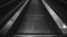 Coming soon text. Moving up on escalator stock video