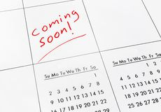 Coming soon. Text in red on a calendar royalty free stock images