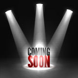 Coming soon. Text in Spotlight shine effects on a dark background. Coming soon in stage spotlight on dark background. Vector scene illuminated spotlight Stock Image