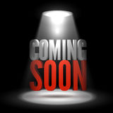 Coming soon. Text in Spotlight shine effects on a dark background Royalty Free Stock Photo