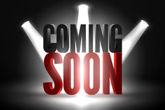 Coming soon. Text in Spotlight shine effects on a dark background Royalty Free Stock Photos