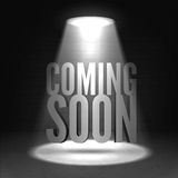 Coming soon. Text in Spotlight shine effects on a dark background Royalty Free Stock Image
