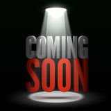 Coming soon. Text in Spotlight shine effects on a dark background Stock Photo