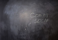 Coming Soon Texts on Black Chalkboard. Conceptual Hand Written Coming Soon Texts on Black Chalkboard Stock Images