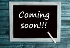 Coming soon words. On chalkboard Stock Photo