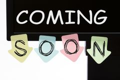 Coming Soon Concept. Coming Soon written on color stickers on computer display. Business concept stock photos
