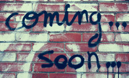 Coming soon. Written on house wall royalty free stock photography