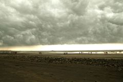The Coming Storm at the beach. In india royalty free stock images