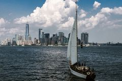 Manhattan from Hudson River. View of sailing boat and Manhattan from the Hudson River stock photos