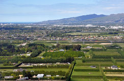 Coming in to Land at Christchurch Airport. About to land at Christchurch Airport New Zealand. An aerial view of Christchurch city. In the foreground are the Stock Image