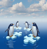Coming Together. With common purpose to assemble a team partnership to form a strong group with four penguins merging floating chunks of ice in the shape of Stock Photography