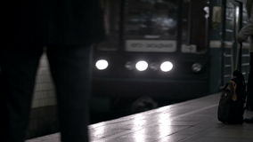 Coming train in underground. Train coming to underground station with people on platform waiting. Russia stock footage