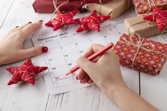 Coming xmas day. Highlighting christmas date on calendar with gift box Stock Image