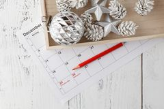 Coming xmas day. Highlighting christmas date on calendar with gift box Royalty Free Stock Images