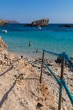 Comino blue lagoon beach. The stunningly beautiful holiday destination sandy beach of comino and crystal clear azure turquoise blue waters of the Blue Lagoon Royalty Free Stock Photo